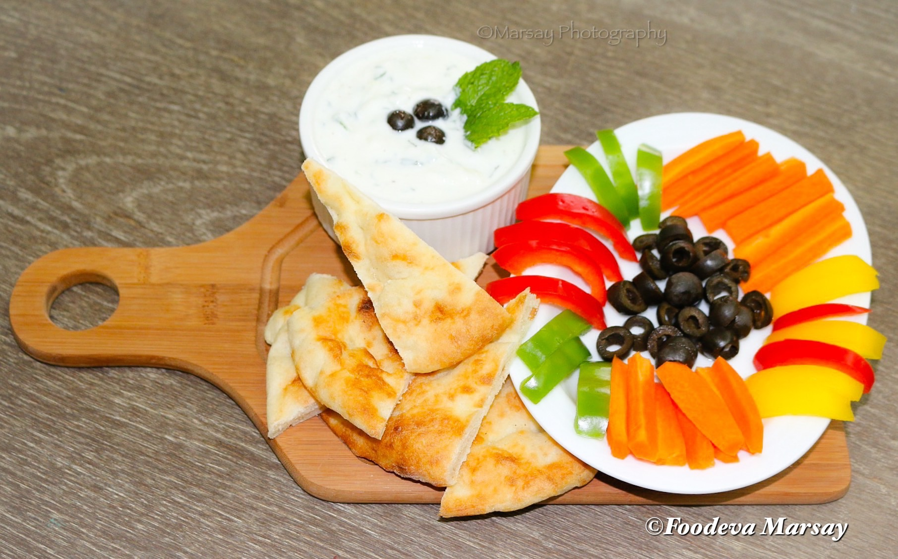 Middle Eastern Cucumber Yoghurt Sauce...served here with Arabic Bread and sliced Carrots, olives and sliced peppers