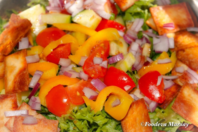 Gently toss salad ingredients before plating